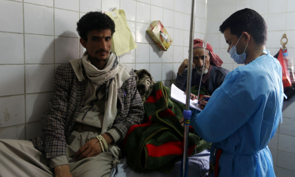 Yemeni men suspected of being infected with cholera receive treatment at a hospital in Sanaa on May 12, 2017.  Mohammed HUWAIS / AFP
