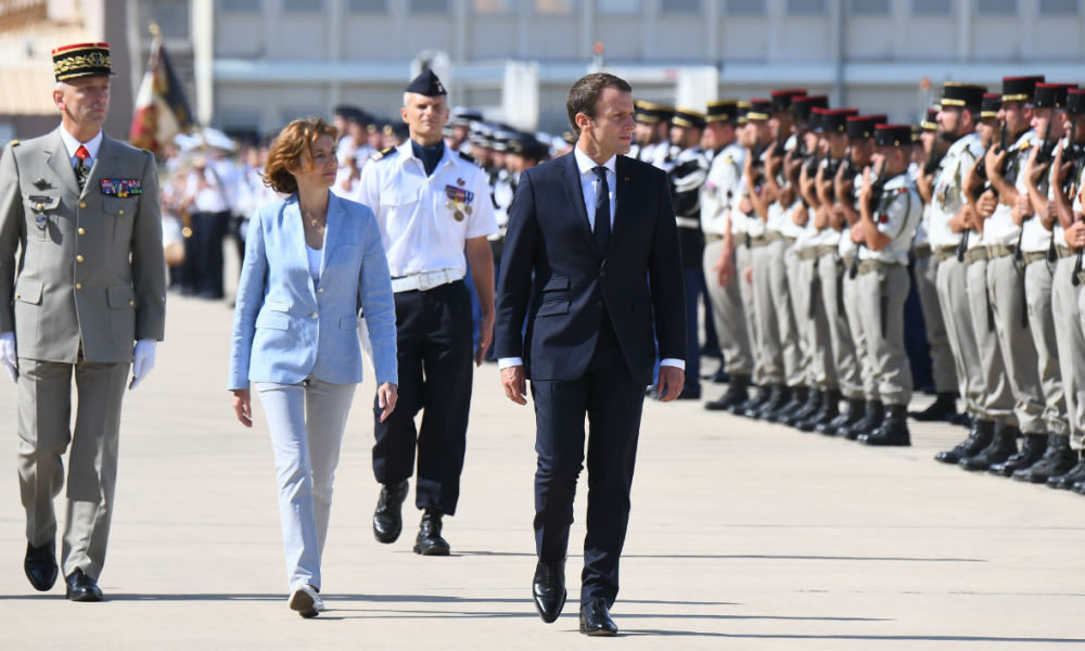 (From R) French President Emmanuel Macron, French Defence Minister Florence Parly and newly appointed French army Chief of Military Staff Francois Lecointre review an honour guard at an air force base (BA 125) in Istres on July 20, 2017. French President Emmanuel Macron will deliver a speech at the air force base after the former armed forces chief General Pierre de Villiers resigned over questions regarding military spending. Anne-Christine POUJOULAT / AFP