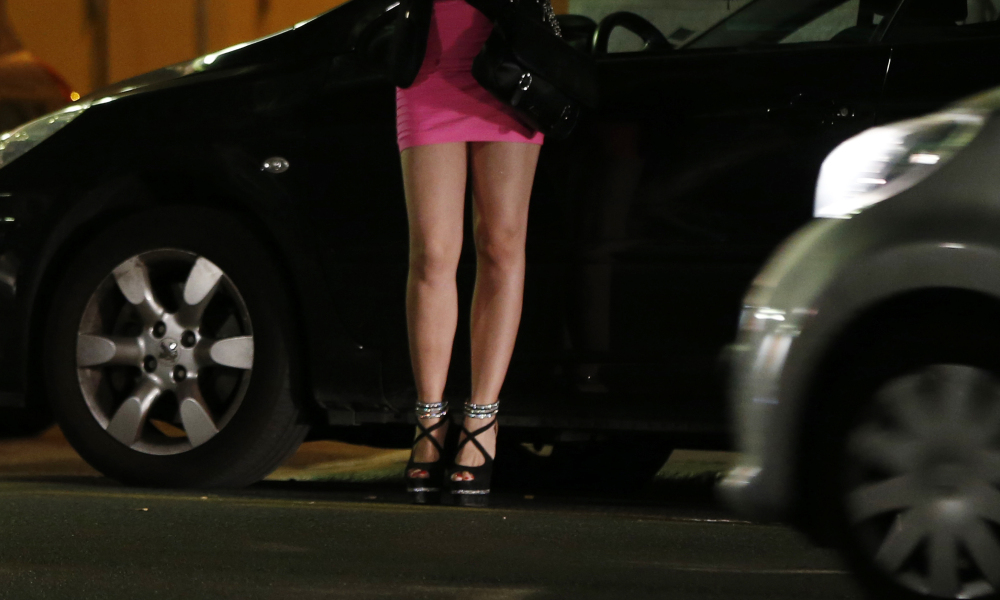 This file photo taken on September 5, 2015 shows a prostitute waiting for clients in a street of the French southeastern city of Nice. The French government will give a final reading on April 6, 2016, at the National Assembly on the bill on prostitution. The key measure for the proposed law will allow for the criminalization of clients.