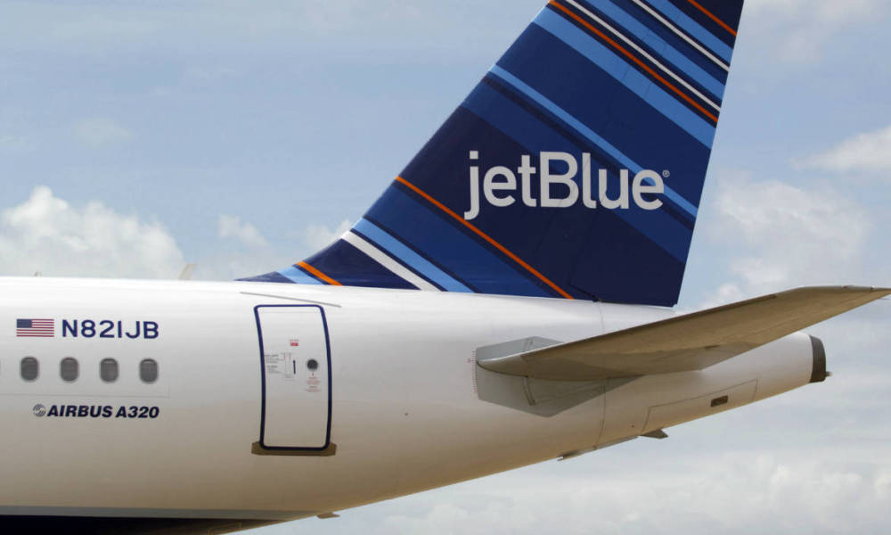 A JetBlue A320 is parked at Brookley Field after a ground breaking ceremony for an assembly line for the Airbus A320 at Brookley Aeroplex in Mobile, Alabama on April 8, 2013. AFP PHOTO/ Matthew Hinton Matthew HINTON / AFP