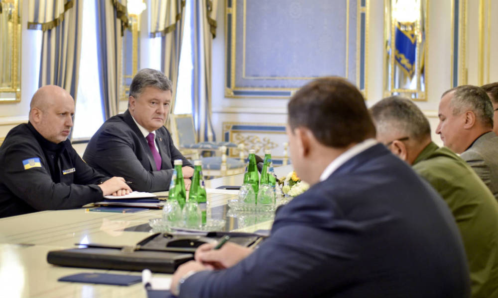 "This handout picture taken and released by Ukrainian Presidential press service in Kiev on August 11, 2016 shows Ukrainian President Petro Poroshenko (2L) speaking to the country's high-ranking military officials during their meeting. Ukrainian President Petro Poroshenko put the military on a heightened state of alert along the frontier with Crimea following Russia's accusations of Kiev's attempted incursions into the disputed region. Moscow's FSB security service said on August 10 it had earlier this week thwarted ""terrorist attacks"" by Ukraine's military on the Black Sea peninsula that Russia annexed from Ukraine in March 2014."