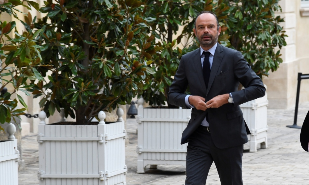 French Prime Minister Edouard Philippe (L) arrives for a meeting with the French union Force Ouvriere (FO) Confederal Secretary, at Hotel de Matignon in Paris, on August 30, 2018.  Bertrand GUAY / AFP