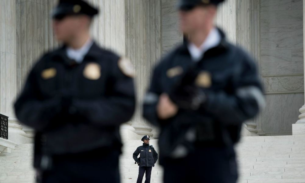 Police guard the outside the US Supreme Court while arguments in the Masterpiece Cakeshop vs. Colorado case are heard December 5, 2017 in Washington, DC. The US Supreme Court is to hear arguments on Tuesday in a case that has been described as the most significant for gay rights since it approved same-sex marriage two years ago.