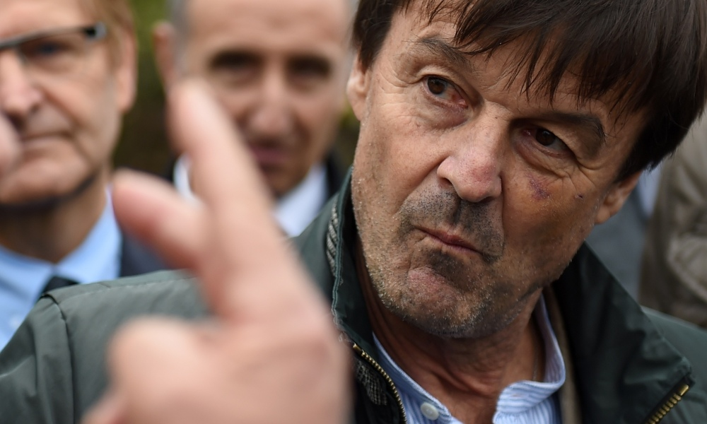 French Ecology Minister Nicolas Hulot (R) speaks to a farmer at a GAEC (Groupement Agricole d'Exploitation en Commun) farming collective during a visit to the Loir-et-Cher department in Couffy, central France, on October 27, 2017.  GUILLAUME SOUVANT / AFP