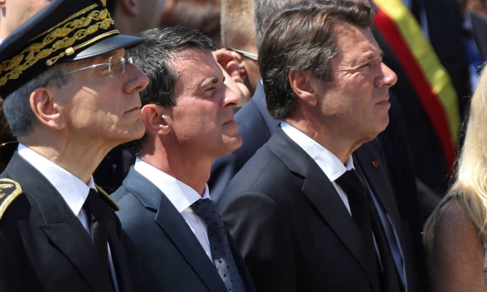 From L) French minister for Social Affairs, Health Marisol Touraine, mayor of Nice Philippe Pradal, Prefect of the Alpes-Maritimes department Adolphe Colrat, French Prime minister Manuel Valls, President of the Provence Alpes Cote d'Azur region Christian Estrosi and US Ambassador to France Jane Hartley observe a minute of silence on the Promenade des Anglais in Nice on July 18, 2016, in tribute to victims of the deadly Nice attack on Bastille day. France fell silent on July 18, 2016, for the victims of the Nice truck attack, but the mourning was overshadowed by politicians tearing into each other over the massacre. A sea of people thronged the Nice promenade for the emotional minute's silence just days after a Tunisian attacker drove a truck into a crowd at the same place on Bastille Day, killing 84 people and injuring around 300.