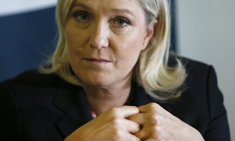 """French far right Front National (FN) party's president Marine Le Pen (L) gives a press conference to launch the """"croissance bleu marine"""" collective on February 19, 2016, in Taverny.  PATRICK KOVARIK / AFP"""