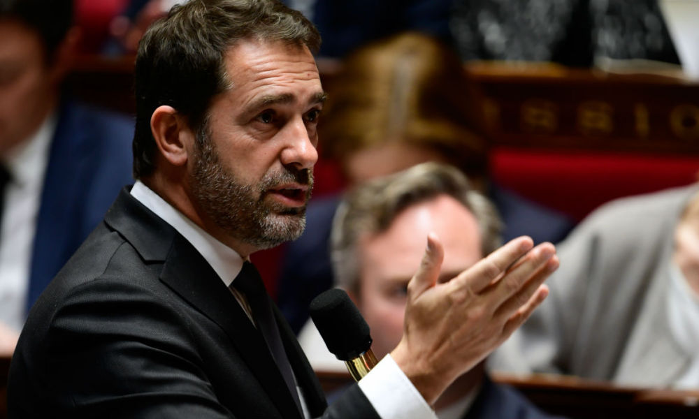 French Junior Minister for the Relations with Parliament and Government Spokesperson Christophe Castaner gestures as he speaks during a session of questions to the government at the National Assembly in Paris on November 15, 2017.  Martin BUREAU / AFP