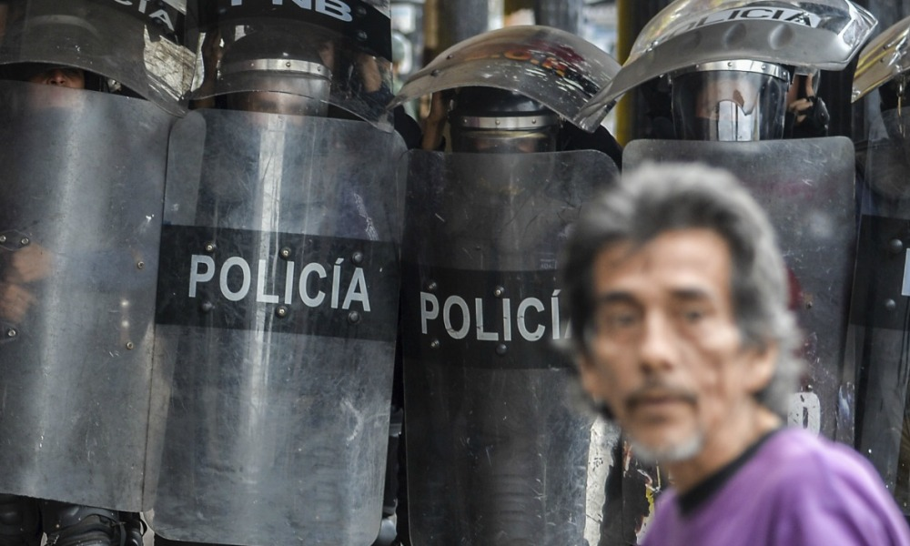 Riot police stand by during a protest against the government of President Nicolas Maduro in San Cristobal, Tachira State, Venezuela, on May 20, 2017. Venezuelan protesters and supporters of embattled President Nicolas Maduro take to the streets Saturday as a deadly political crisis plays out in a divided country on the verge of paralysis. LUIS ROBAYO / AFP