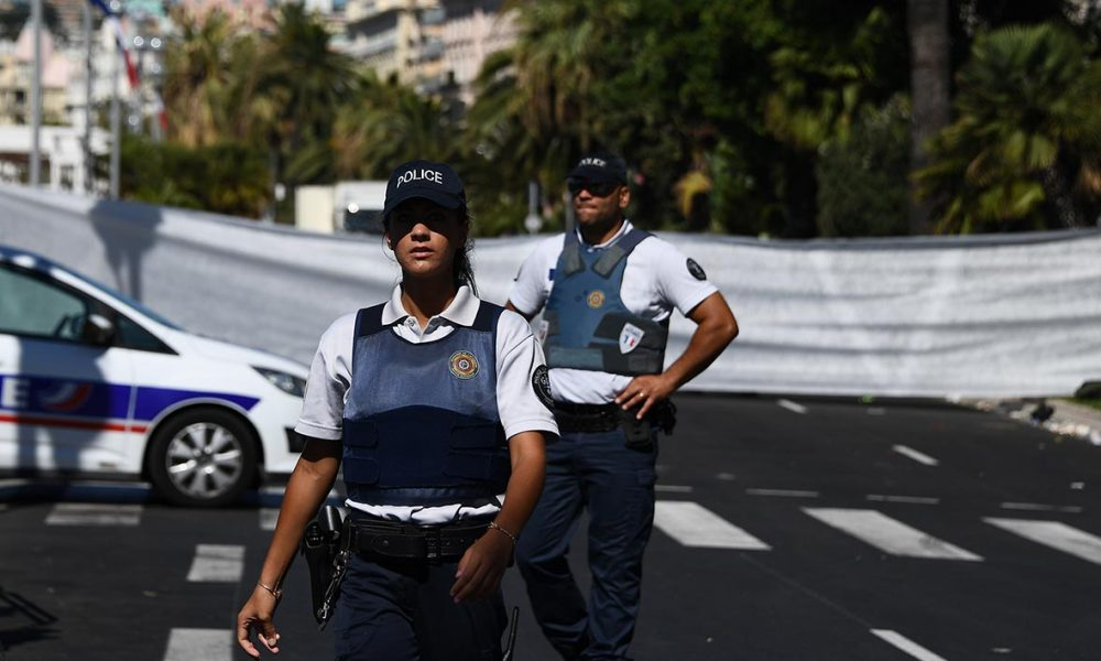 "Policemen stand guard the Promenade des Anglais seafront in the French Riviera town of Nice on July 15, 2016, hours after a truck drove into a crowd watching a fireworks display. An attack in Nice where a man rammed a truck into a crowd of people left 84 dead and another 18 in a ""critical condition"", interior ministry spokesman Pierre-Henry Brandet said Friday. An unidentified gunman barrelled the truck two kilometres (1.3 miles) through a crowd that had been enjoying a fireworks display for France's national day before being shot dead by police.  ANNE-CHRISTINE POUJOULAT / AFP"