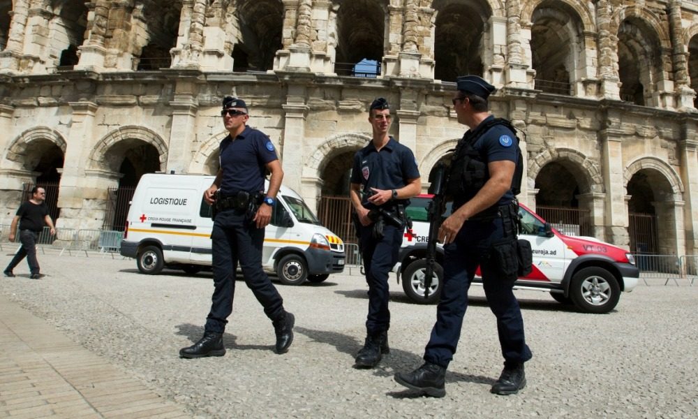 "French police officers patrol at the Arena in Nimes prior to the start of the first stage of the 72nd edition of ""La Vuelta"" Tour of Spain cycling race, on August 19, 2017. JAIME REINA / AFP"