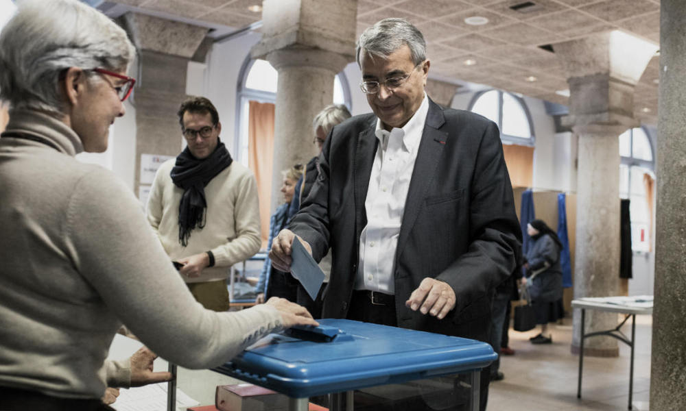 President of the Rhone-Alpes region and Socialist Party (PS) candidate Jean-Jack Queyranne casts his ballot for the first round of the regional elections in the Rhone-Alpes Auvergne region on December 6, 2015 at a polling station in Lyon