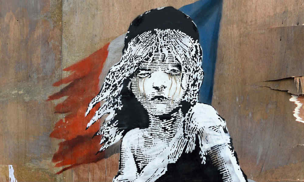 Cosette, personnage central des Misérables de Victor Hugo, dessinée sur un mur par l'artiste Banksy. (Photo d'illustration)