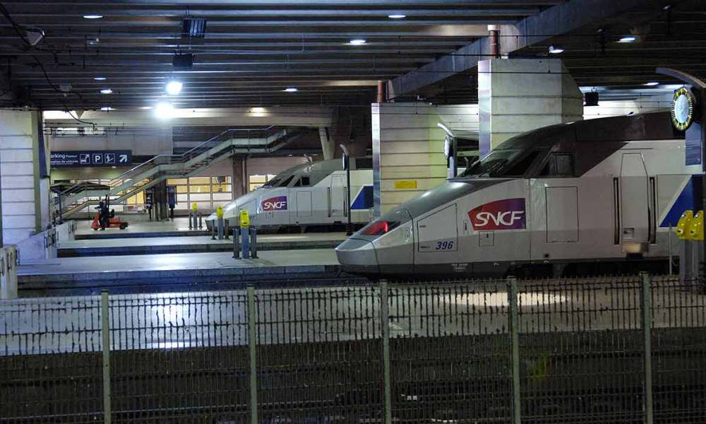 "French TGV (high-speed trains) are seen at the Montparnasse train station, 14 November 2007 in Paris, on the day of a nationwide strike. French unions launch open-ended strikes in public transport, power utilities and elsewhere, education, hospitals, in a major test for President Nicolas Sarkozy's reform plans. They protest against the scrapping of pension privileges that allow some public employees to retire early. The slogan go reads : ""Travellers assistance, work for you"". AFP PHOTO STEPHANE DE SAKUTIN"