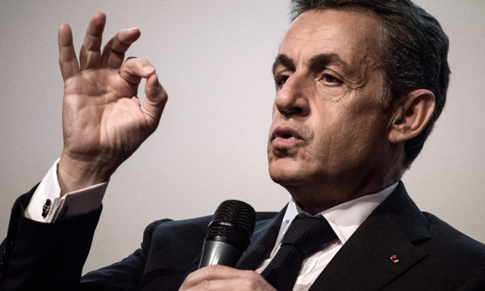Right-wing Les Republicains (LR) party's candidate for the party's primary ahead of the 2017 presidential election, Nicolas Sarkozy takes part in a meeting at the French national construction Federation in Paris on October 25, 2016.  PHILIPPE LOPEZ / AFP