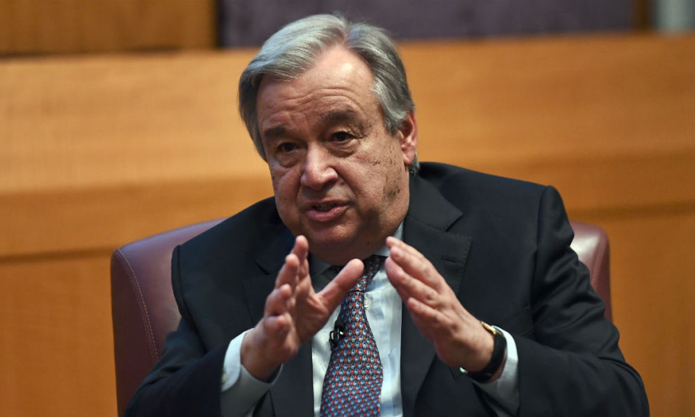 "United Nations Secretary-General Antonio Guterres speaks on climate change at the New York University Stern School of Business, in New York on May 30, 2017. Guterres said it was ""absolutely essential"" that the Paris climate agreement be implemented, as the US weighed pulling out of the emissions-cutting deal. JEWEL SAMAD / AFP"
