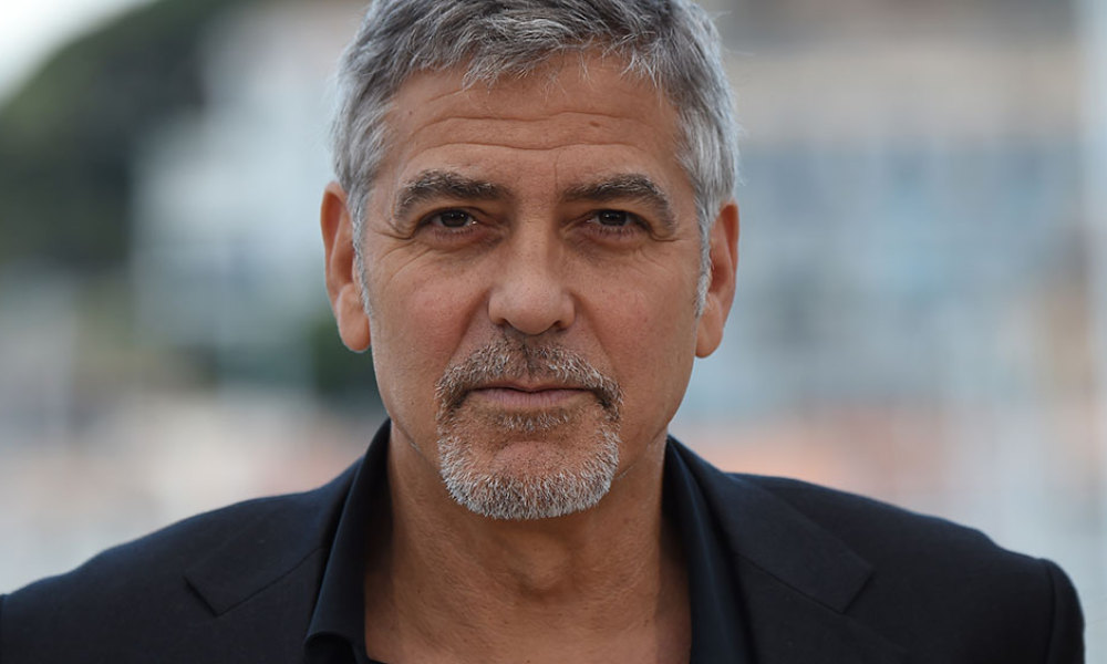 "US actor George Clooney poses on May 12, 2016 during a photocall for the film ""Money Monster"" at the 69th Cannes Film Festival in Cannes, southern France."