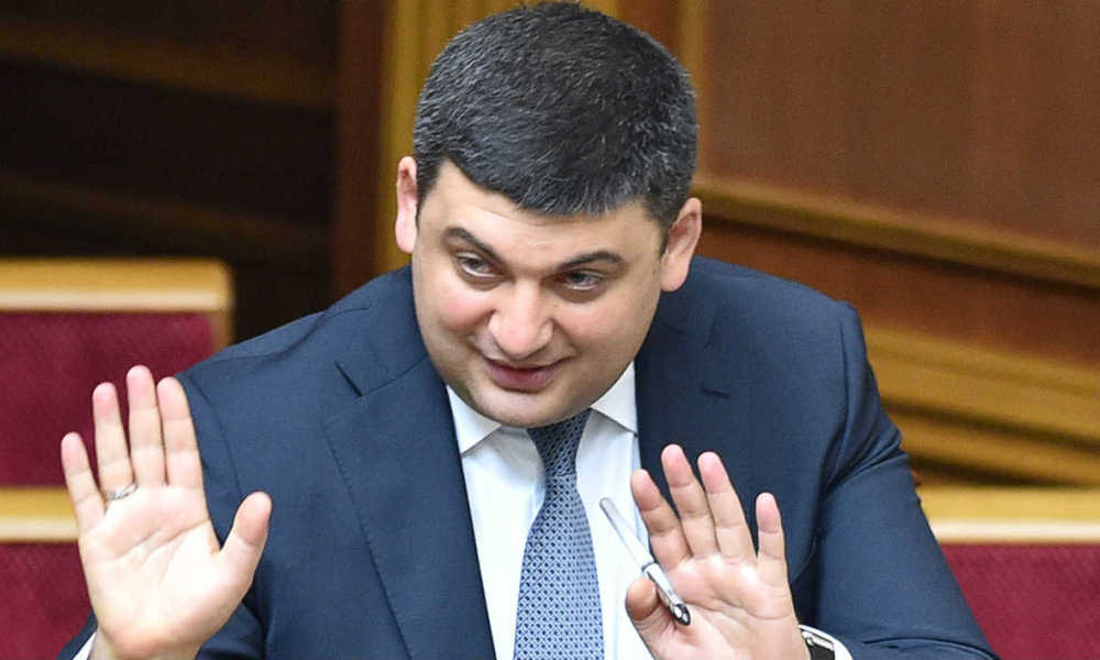 Newly appointed Prime Minister of Ukraine Volodymyr Groysman reacts in Parliament in Kiev on April 14, 2016. Ukraine's parliament on April 14, 2016 appointed pro-Western speaker Volodymyr Groysman as prime minister in a bid to end months of political gridlock and unlock vital aid to the war torn-state. Lawmakers voted by 257 to 50 to approve the resignation of Prime Minister Arseniy Yatsenyuk