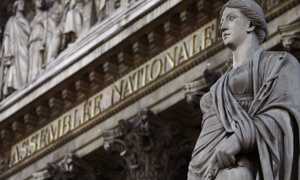 A picture taken on November 16, 2010 shows the frontispiece of the Palais Bourbon where the French National Assembly is located and a statue depicting the Greek mythology titan Themis (R) in Paris. AFP PHOTO JOEL SAGET  Joël SAGET / AFP