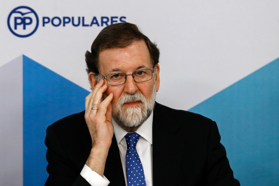Spanish Prime Minister Mariano Rajoy attends a Popular Party (PP) meeting of the national executive committee held one day after the Catalan regional elections, at the PP headquarters in Madrid, on December 22, 2017.