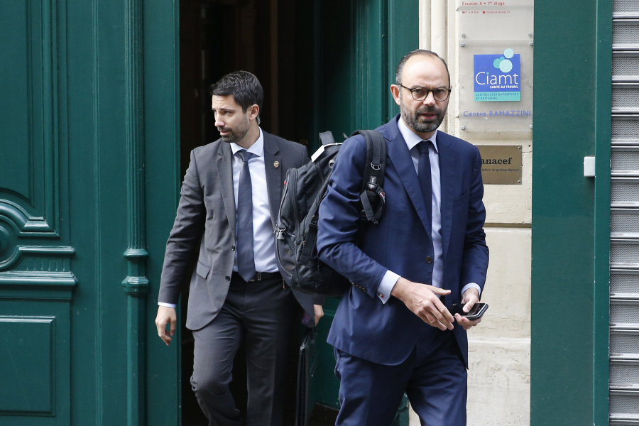 France's newly appointed Prime Minister Edouard Philippe (R) walks out his home in Paris on May 16, 2017 before going to the Hotel Matignon. New French President Emmanuel Macron named centre-right lawmaker Edouard Philippe as prime minister on May 15 in a further effort to splinter the country's traditional parties and redraw the political map. Philippe, a little known 46-year-old MP and mayor of the northern port of Le Havre, comes from the moderate wing of the rightwing Republicans party and is seen as a pragmatist. GEOFFROY VAN DER HASSELT / AFP