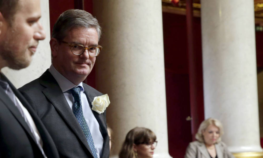 British Ambassador to France Julian King (R) holds, along French deputies and government members, a moment of silence for slain British Labour party MP Joe Cox during the questions to the government session on June 21, 2016 at the French National Asssembly in Paris.