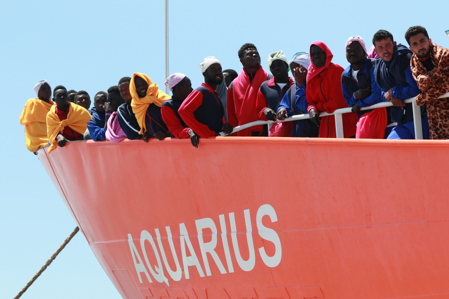 The Aquarius rescue Ship run by NGO S.O.S. Mediterranee and Medecins Sans Frontieres arrive in the port of Salerno with 1004 migrants including 240 children rescued in the Mediterranean sea, on May 26 2017. More than 50,000 migrants have landed on Italian coasts since the beginning of this year, not counting those rescued in recent days, while more than 1,400 have drowned or are missing, according to the UN. CARLO HERMANN / AFP