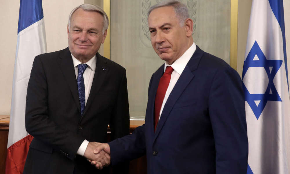 Israeli Prime Minister Benjamin Netanyahu (R) shakes hands with French Foreign Minister Jean-Marc Ayrault on May 15, 2016 during a meeting at the Prime Minister's office in Jerusalem. Ayrault met Netanyahu and before meeting Palestinian president Mahmud Abbas ahead of a France-sponsored Middle East peace process summit in Paris on May 30. Israel has rejected the initiative, the Palestinians support it and the United States has been cold.