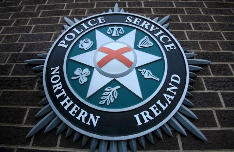 "A coat of arms is pictured at the Police Service of Northern Ireland (PSNI) Headquarters in Belfast, Northern Ireland, on February 5, 2010. Northern Ireland's leaders announced a hard-fought accord to transfer key remaining powers from London to Belfast on Friday, hailed as opening a ""new chapter"" in the long-troubled province. Responsibility for police and justice in Northern Ireland will transfer to Belfast from April 12, they said, flanked by British Prime Minister Gordon Brown and his Irish counterpart Brian Cowen who flew in for the occasion. AFP PHOTO/Peter Muhly"
