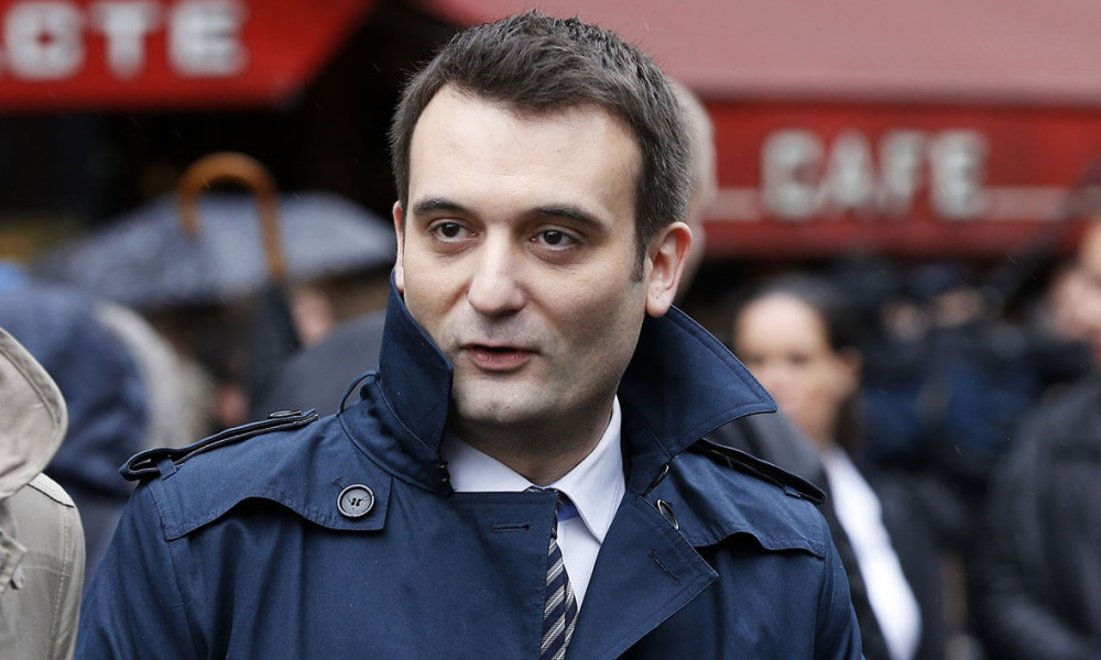 """In this file picture taken on May 1, 2015 French far-right Front National (FN) party's vice-president Florian Philippot during the party's annual rally in honour of Jeanne d'Arc (Joan of Arc) in Paris. A decssion is expected on June 30, 2015 in the appeal concerning Closer magazine, initially ordered by the court to pay 20,000 euros in damages to Florian Philippot for the """"outing"""" the vice president of the Front National."""
