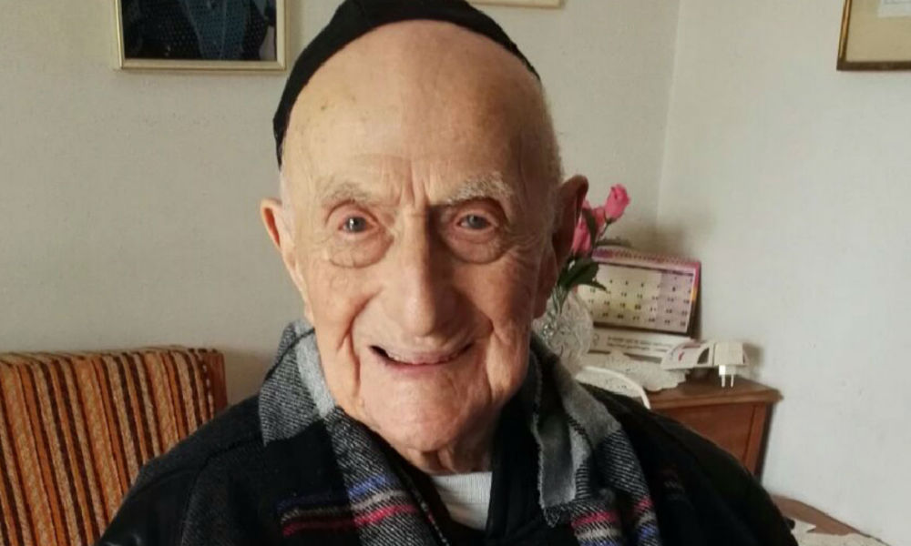 A picture taken on January 21, 2016, shows Yisrael Kristal sitting in his home in the Israeli city of Haifa. Yisrael, an Israeli Holocaust survivor, may be the world's oldest man at 112, Guinness World Records said, providing he can find the documents to prove it. SHULA KOPERSHTOUK / AFP