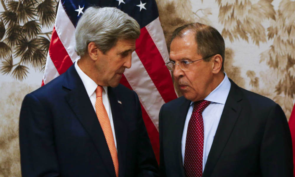 US Secretary of State John Kerry (L) and Russian Foreign Minister Sergei Lavrov (R) pose for a photo as they arrive for their meeting in Vienna on May 16, 2016 in Vienna, Austria. World powers said they supported the lifting of an arms embargo on Libya and were ready to supply weapons to the country's new unity government to help it fight the growing threat posed by the Islamic State group.