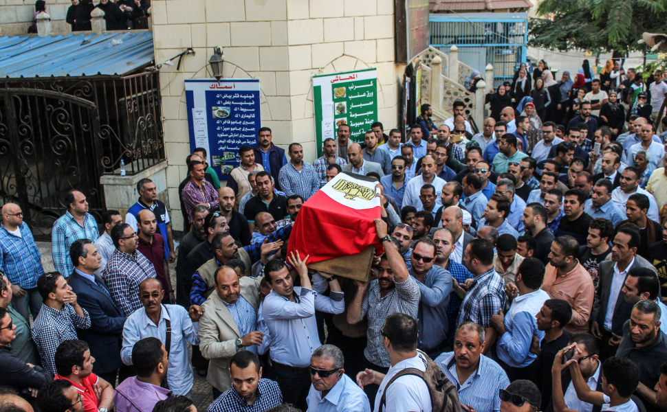 Egyptians carry the coffin of Police Cpt. Ahmed Fayez during his funeral outside a mosque in the capital Cairo's western suburb of Sixth of October, on October 21, 2017.