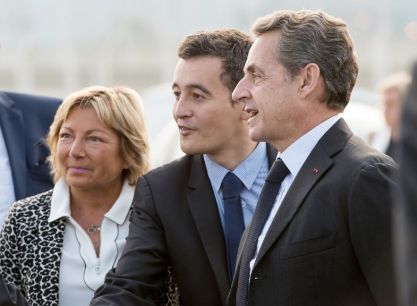 Former French president and candidate for the right-wing Les Republicains (LR) party primary ahead of the 2017 presidential election, Nicolas Sarkozy (R) flanked by Campaign director Gerard Darmanin and Calais Mayor Natacha Bouchart (R) arrives for a visit at Calais harbour, northern France, on September 21, 2016. Seven candidates including ex-president Nicolas Sarkozy were confirmed on September 21 to contest the rightwing primary to pick a nominee for France's presidential election next year, officials said.