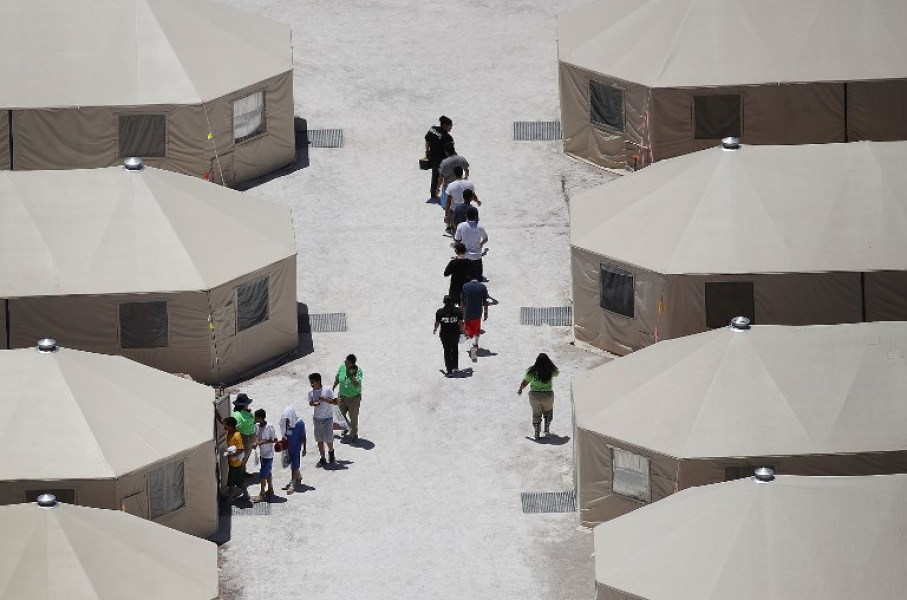 Children and workers are seen at a tent encampment recently built near the Tornillo Port of Entry on June 19, 2018 in Tornillo, Texas. The Trump administration is using the Tornillo tent facility to house immigrant children separated from their parents after they were caught entering the U.S. under the administration's zero tolerance policy. Joe Raedle/Getty Images/AFP  JOE RAEDLE / GETTY IMAGES NORTH AMERICA / AFP