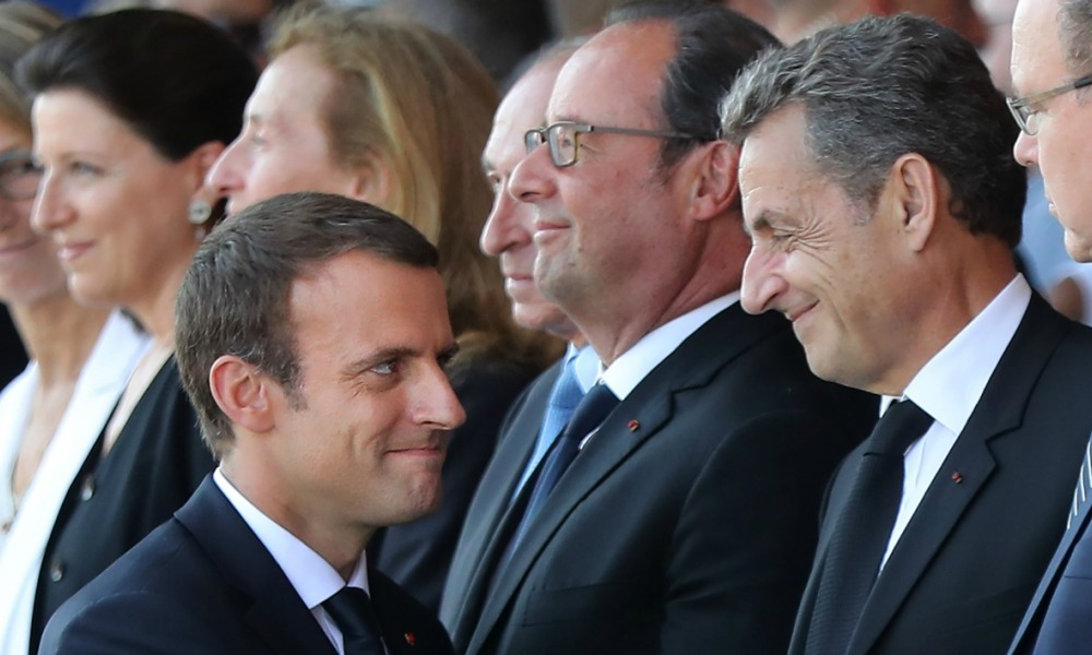 French President Emmanuel Macron (L) greets former French presidents Francois Hollande and Nicolas Sarkozy during a commemorative ceremony marking the first anniversary of a jihadist truck attack which killed 86 people in Nice, southern France, on Bastille Day, July 14, 2017.