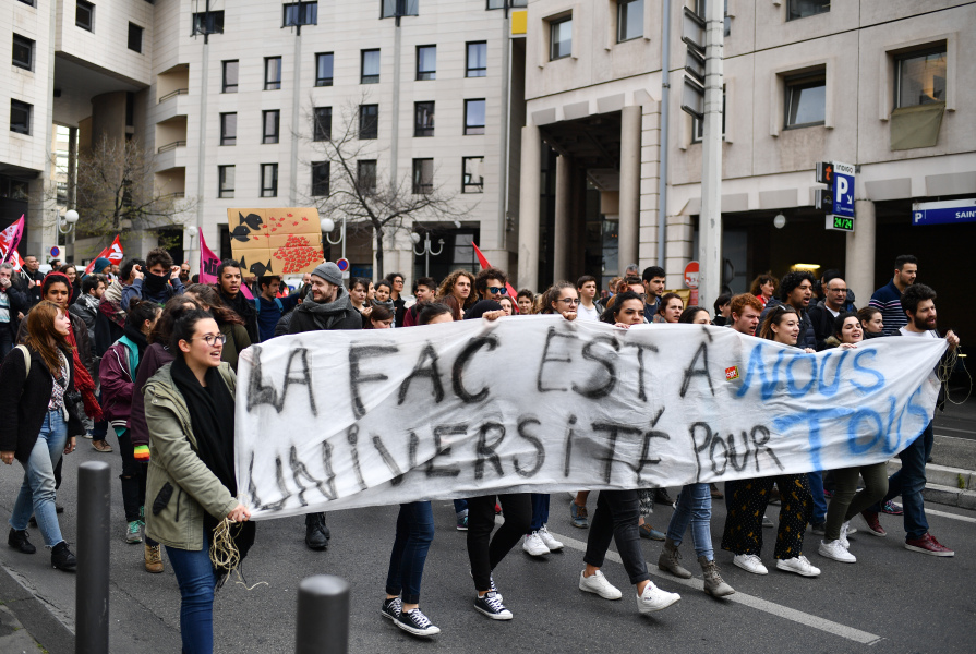 Students protest against the French President's plans to make university entry more selective, joining a slew of nationwide sit-ins that have disrupted classes for weeks in the southern coastal city of Marseille on April 4, 2018.