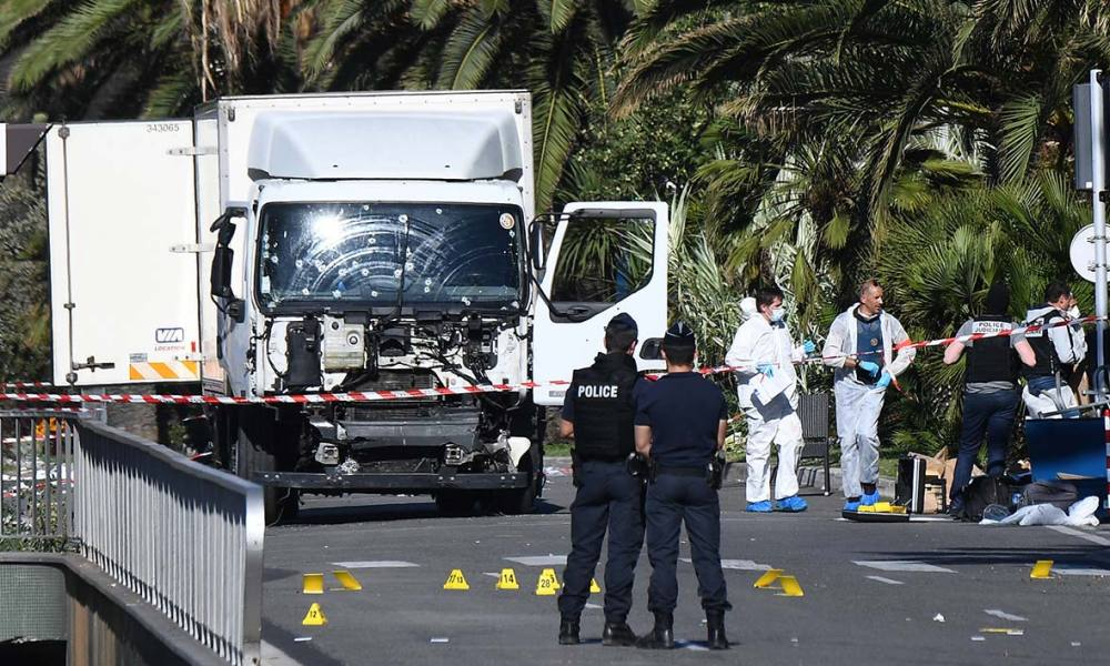 "Forensics officers and policemen look for evidences in a truck on the Promenade des Anglais seafront in the French Riviera town of Nice on July 15, 2016, after it drove into a crowd watching a fireworks display. An attack in Nice where a man rammed a truck into a crowd of people left 84 dead and another 18 in a ""critical condition"", interior ministry spokesman Pierre-Henry Brandet said Friday. An unidentified gunman barrelled the truck two kilometres (1.3 miles) through a crowd that had been enjoying a fireworks display for France's national day before being shot dead by police.  ANNE-CHRISTINE POUJOULAT / AFP"