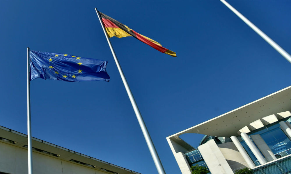 The European and German flags are on display outside the Chancellery in Berlin on June 24, 2016, where German governement and MPs are to meet after the so-called Brexit referendum.  John MACDOUGALL / AFP