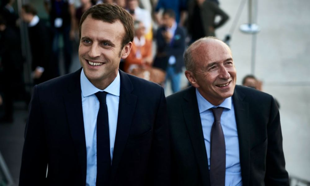 "Former French Economy Minister and founder of the political movement ""En Marche"" (On the Move) Emmanuel Macron (L) and Mayor of Lyon Gerard Collomb attend the European Reformists summit in Lyon on September 24, 2016.  JEAN-PHILIPPE KSIAZEK / AFP"