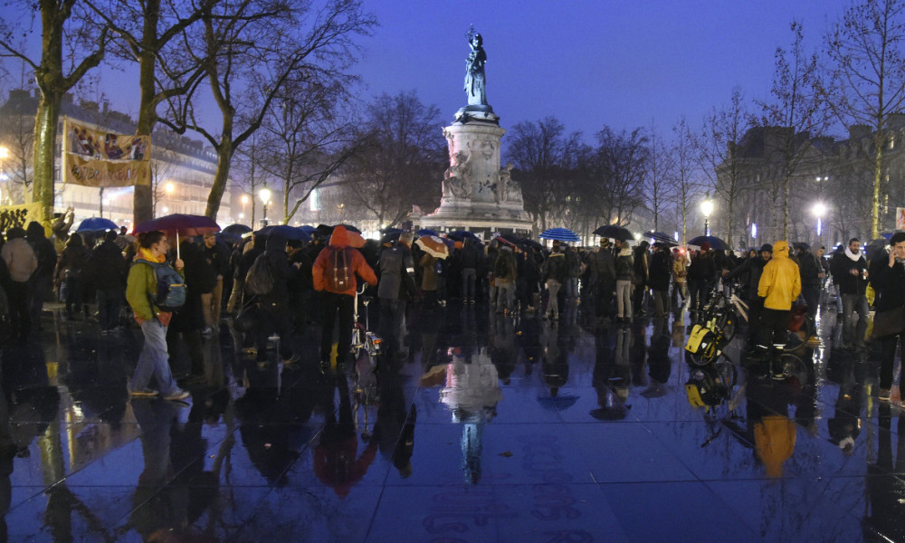 """People join the """"Nuit Debout"""" or """"Standing night"""" movement at the Place de la Republique in Paris on April 2, 2016. A few hundred people rallied to demand the halt of """"home evictions"""" which can begin the day after the end of the French winter break, after which tenants can be evicted from their homes. They also gathered to show their opposition to the labor reform law in the wake of the nationwide demonstration which took place on March 31."""