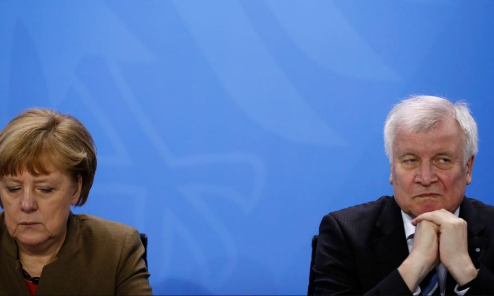 In this file photo taken on April 14, 2016, German Chancellor Angela Merkel (L) and then Bavarian state premier and leader of the conservative Christian Social Union (CSU) Horst Seehofer give a press conference at the Chancellery in Berlin.