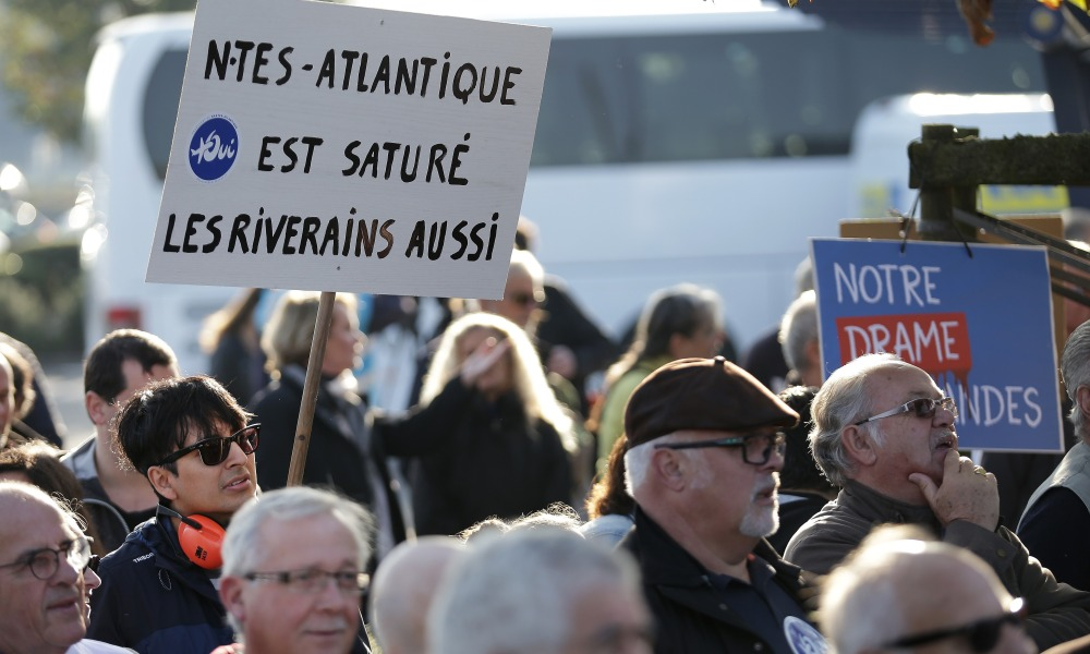 Supporters of the international airport project of Notre-Dame-des-Landes, demonstrate in front the Nantes Atlantique aiport on October 14, 2017 in Bouguenais, western France. The project has sparked years of protests which kept on postponing its opening, initially scheduled for October 2017.  Jean-Sebastien EVRARD / AFP