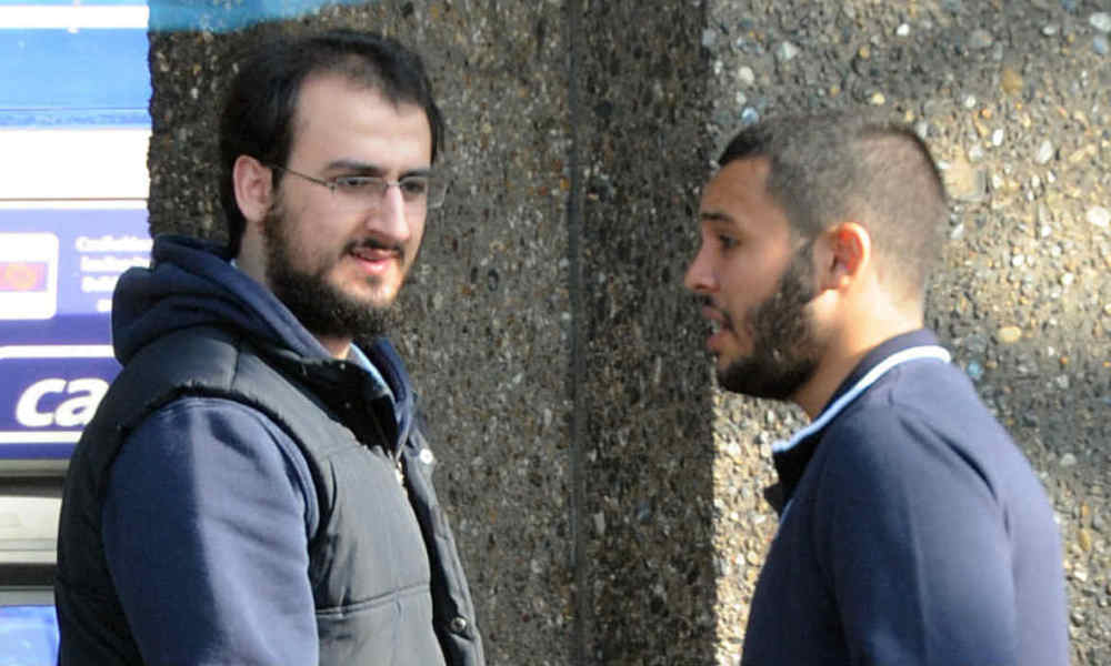 An undated handout photo released by Britain's Metropolitan Police Service in London on March 23, 2016, shows Tarik Hassane (R) and Suhaib Majeed as they are pictured during a police surveillance operation. A man was found guilty in London on Wednesday of a 2014 plot to kill police, troops and civilians in a drive-by shooting inspired by Islamic State (IS) group jihadists. Suhaib Majeed, 21, was convicted on March 23, 2016, of conspiracy to murder and preparation of terrorist acts, following a trial in the British capital. His school friend, Hassane, pleaded guilty to the same charges in February 2016.  HO / Metropolitan Police Service / AFP