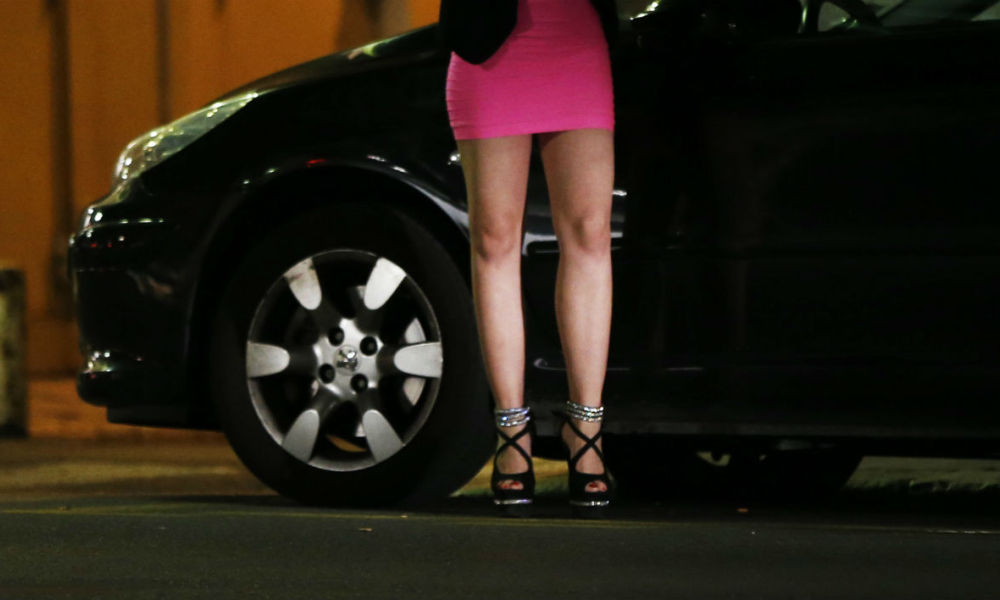 A prostitute waits for clients in a street of the French southeastern city of Nice, on September 5, 2015. AFP PHOTO / VALERY HACHE  VALERY HACHE / AFP