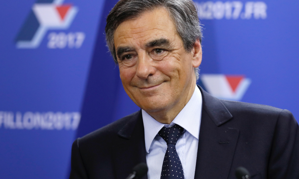 Candidate for the right-wing Les Republicains (LR) party primaries ahead of the 2017 presidential election and former French prime minister, Francois Fillon reacts at his campaign headquarters after finishing first of the first round of the rightwing presidential primary, on November 20, 2016 in Paris. Thomas SAMSON / POOL / AFP