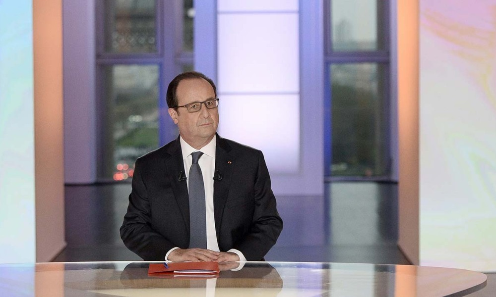"French President François Hollande is seen in a studio set-up by France 2, a public television station, at the Musee de L'homme as he faces 90-minutes of questioning from a panel of journalists and four French voters during a programme called ""Dialogues Citoyens"" -""Citizen's Dialogue"" on April 14, 2016, in Paris."