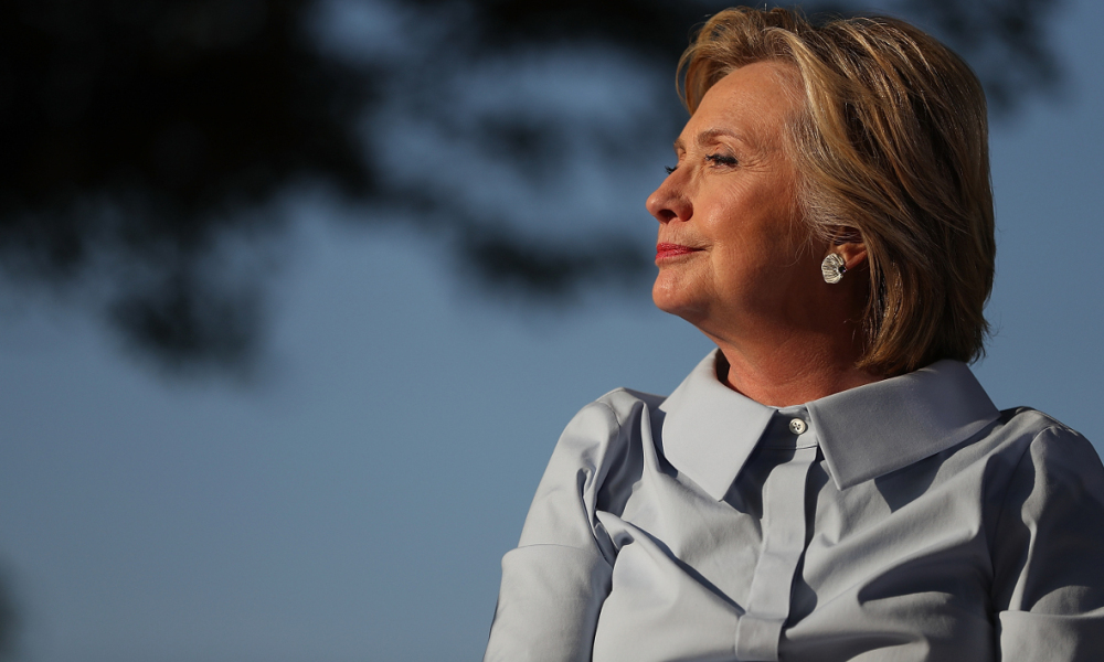 HAMPTON, IL - SEPTEMBER 05: Democratic presidential nominee Hillary Clinton looks on at the 49th annual Salute to Labor on September 5, 2016 in Hampton, Illinois. Clinton is kicking off a Labor Day campaign swing to Ohio and Iowa on a new campaign plane. Justin Sullivan/Getty Images/AFP  JUSTIN SULLIVAN / GETTY IMAGES NORTH AMERICA / AFP