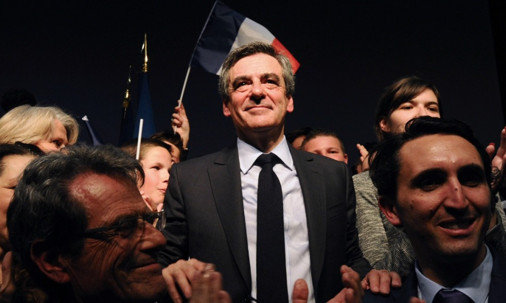 French presidential election candidate for the right-wing Les Republicains (LR) party Francois Fillon (C) stands amongst supporters after delivering a speech during a campaign rally on March 15, 2017 in Pertuis, southern France.  Franck PENNANT / AFP