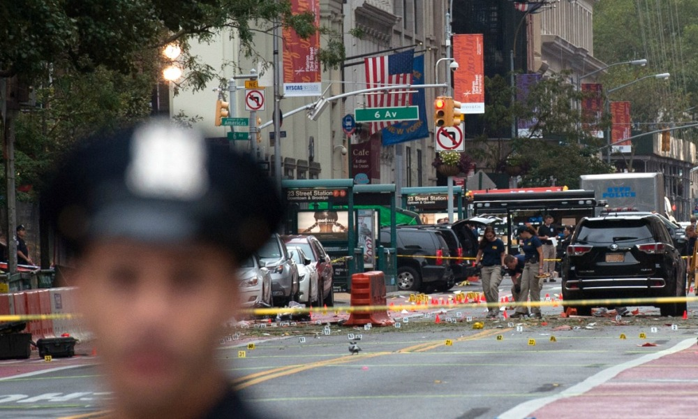 NEW YORK, NY - SEPTEMBER 18: Police process the crime scene of remnants of bomb debris following an explosion on 23rd St. in Manhattan's Chelsea neighborhood on September 18, 2016 in New York City.