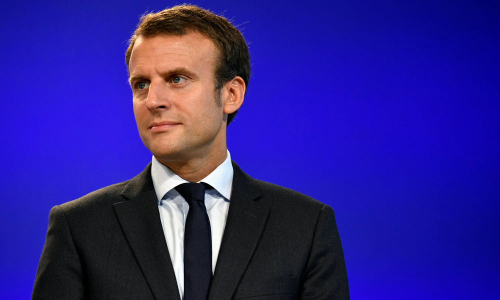 "France's former Minister of the Economy Emmanuel Macron looks on after handling over power to French Minister of Finance and also current Minister of Economy Michel Sapin in Paris, on August 31, 2016 following his resignation as economy minister. France's Emmanuel Macron vowed after stepping down as economy minister on August 30, 2016 to ""transform"" an ailing country but stopped short of declaring a presidential run. The 38-year-old said he had ""seen at first hand the limits of our political system"" and that quitting the government of President Francois Hollande would enable him ""to be free"" to push forward his own agenda.  PHILIPPE LOPEZ / AFP"